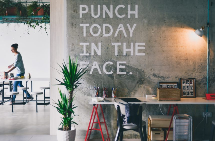 cafe with punch today in the face painted on wall above table